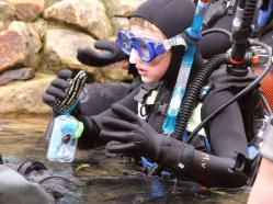 Child in diving suit in the underwater park